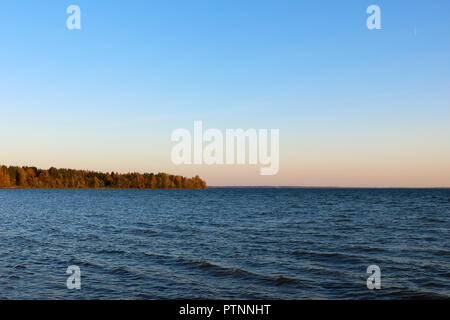 Beautiful view of the blue sky and the lake. - Stock Photo