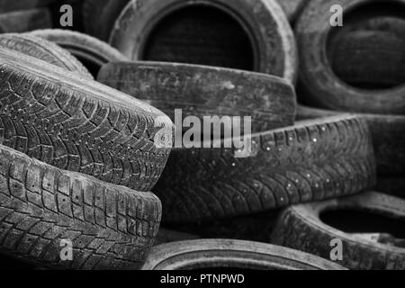 old tires used worn for recycling waste management industry disposal - Stock Photo