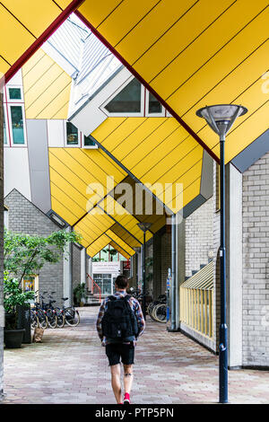 Rotterdam, Netherlands - May 22, 2018: Man walking through repeating cube pattern of Cube Houses. It is a set of innovative houses based on the concep - Stock Photo