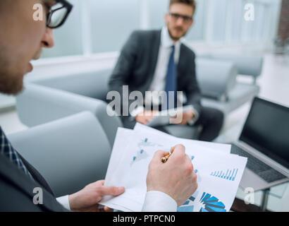 close up.businessman checks the financial document - Stock Photo
