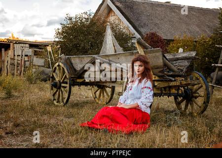 beautiful girl in the national Slavic costume. - Stock Photo
