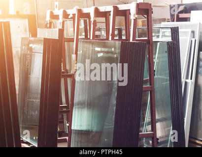 Production of pvc windows, ready-made double-glazed windows for assembly in a plastic pvc frame, shop - Stock Photo