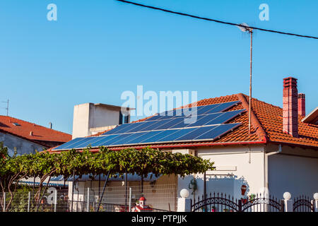 Solar cell panels are using renewable sun energy for making electricity, placed on house roof. Modern energy saving technology - Stock Photo