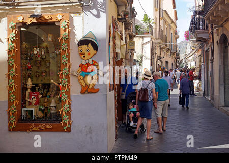 Pinoccicio shop at Corso Umberto I, main road and shopping mile of the old town of Taormina, Sicily, Italy - Stock Photo