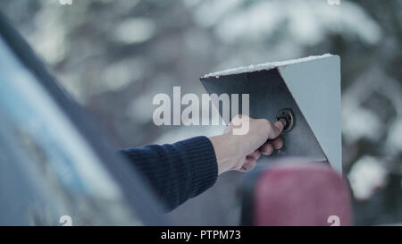 Man's hand puts the chip to the electronic barrier on security c - Stock Photo