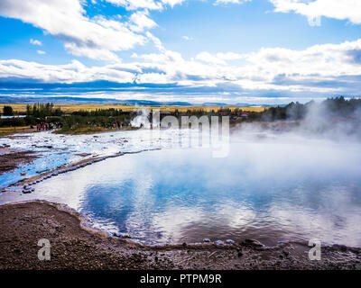 Steaming geothermal pool at Geyser at the Golden Circle Iceland - Stock Photo