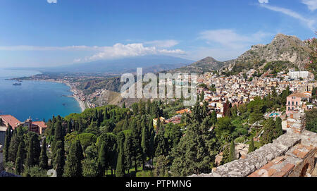 Splendid view from the ancient greek-roman theatre of Taormina to the bay of Giardini-Naxos, Sicily, Italy - Stock Photo