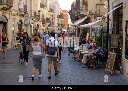 Corso Umberto I, main road and shopping mile of the old town of Taormina, Sicily, Italy - Stock Photo