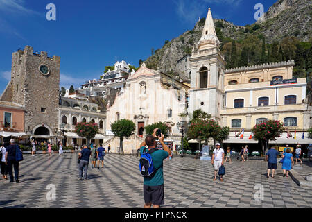 Church of San Giuseppe and clock tower Torre dell'Orolorgio at Piazza IX. Aprile, old town of Taormina, Sicily, Italy - Stock Photo