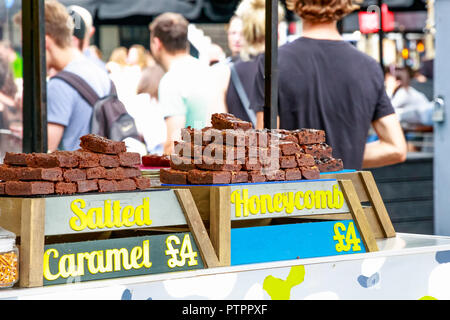 Brownies in a variety of flavours on display at Camden Market in London - Stock Photo