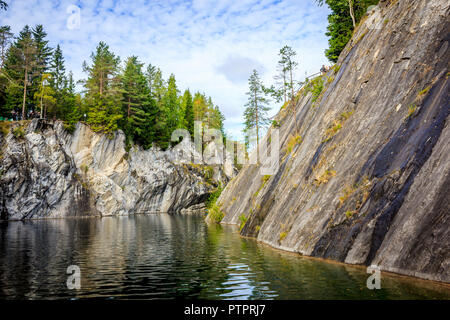 Marble quarry Ruskeala. Invalid marble quarry. Sights of Karelia in Russia. Quarry marble. Pieces and layers of marble. - Stock Photo