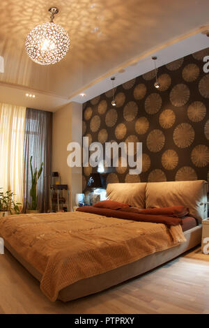 Interior of a modern bedroom in brown tones - Stock Photo