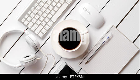 Devices and stationery near hot drink - Stock Photo