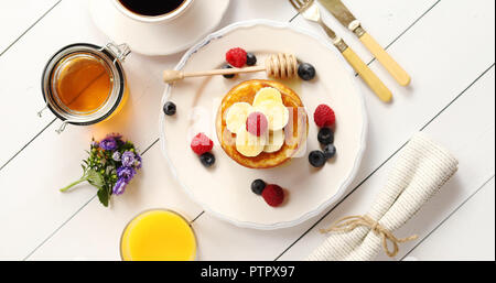 Delicious breakfast food composition - Stock Photo