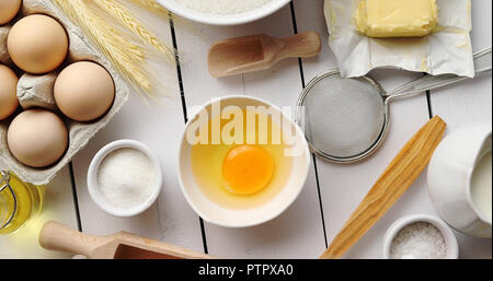 Utensils and pastry ingredients on table - Stock Photo