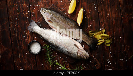 Fresh trout with lemon on board - Stock Photo