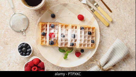 Waffles served on plate with berries - Stock Photo