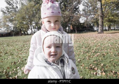 Little boy and girl on a meadow, portrait (Modellfreigabe) - Stock Photo