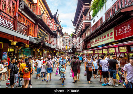 Shanghai, China - July 21st. 2016 - Local and tourists enjoying a hot summer day in downtown Shanghai in China, Asia. - Stock Photo