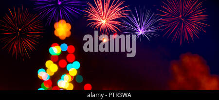 Unfocused Christmas Tree with a Fireworks by Night - Stock Photo