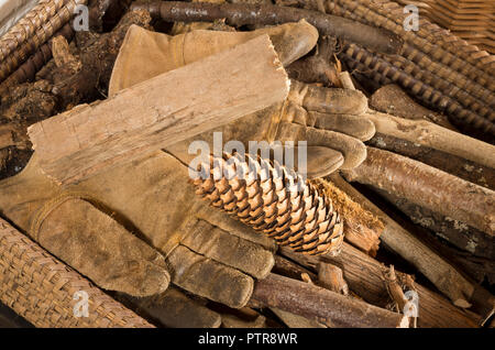 Straight from the log store - a basket of cut sticks and logs for burning in a woodburning stove in winter - Stock Photo