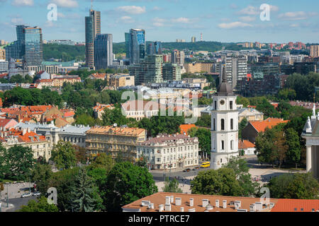 Vilnius cityscape, aerial view of the old town Cathedral Square area with the modern buildings of the Snipiskes business district in the distance. - Stock Photo