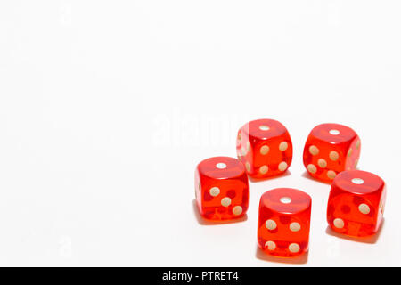 Red dice, typical gambling. With white background and copy space. - Stock Photo