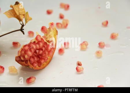 Fruits background - raw pomegranates on white background, healthy season food/cosmetic concept - Stock Photo