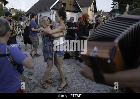 Sneznik, Inner Carniola, Slovenia. 14th Mar, 2018. Dance and music on the streets of Sneznik during the festival.The Snežnik/floating castle festival, during the festival cultural and natural pearl, comes to life in a completely new dimension and connects foreign artists and locals in a unique way, The castle and its surroundings feature a wide variety of music and concert experiences performed by both, established international artists and local enthusiasts. The great attraction of the festival is Ethno Histeria World Orchestra, an international music group of 80 members, which constant - Stock Photo