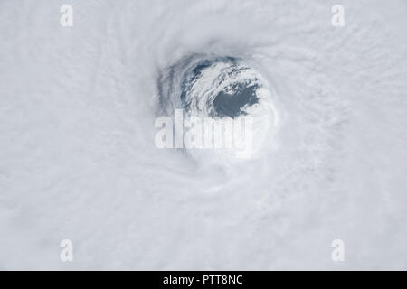 Florida Panhandle, USA. 10th Oct 2018. View from the International Space Station of Hurricane Michael as it churns strikes the Panhandle of Northwest Florida as a Category 4 storm with 145mph winds and heavy rain October 10, 2018 in Earth Orbit. Credit: Planetpix/Alamy Live News - Stock Photo