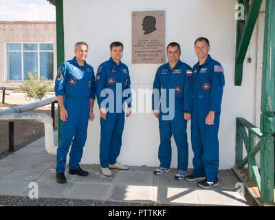 Expedition 57 prime and backup crew pose in front of the cottage where the Russian space icon and Sergei Korolev slept on the night before Yuri Gagarin launched becoming the first human in space at the Baikonur Cosmodrome October 6, 2018 in Baikonur, Kazakhstan.  From left to right are backup crew David Saint-Jacques of the Canadian Space Agency and Oleg Kononenko of Roscosmos, and prime crew Alexey Ovchinin of Roscosmos and Nick Hague of NASA. - Stock Photo