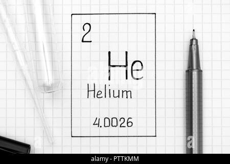 The Periodic table of elements. Handwriting chemical element Helium He with black pen, test tube and pipette. Close-up. - Stock Photo