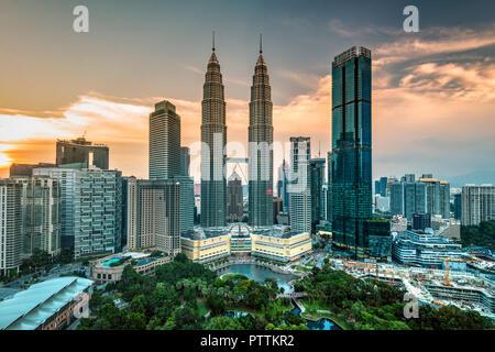 City skyline with Petronas Towers at sunset, Kuala Lumpur, Malaysia - Stock Photo
