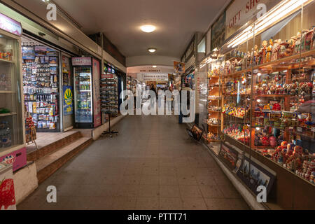 Tourists in a Souvenirs shopping passage in Prague, Czech Republic. - Stock Photo