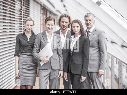 Businessteam aus fuenf Personen (model-released) - Stock Photo