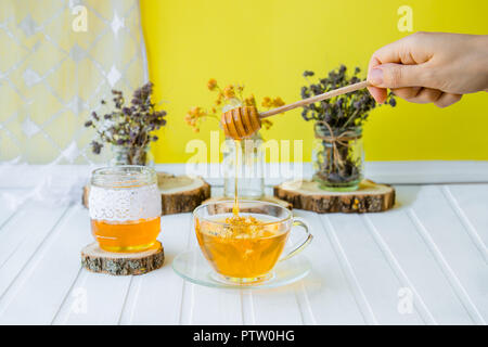 Linden inflorescences, herbal tea, view from high angle, space for a text. On a white table. - Stock Photo