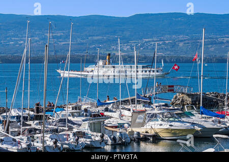 Swiss historic Belle Epoque paddle steamboat Savoie and sailing boats in the marina at Yvoire along Lake Geneva / lac Léman, Haute-Savoie, France - Stock Photo