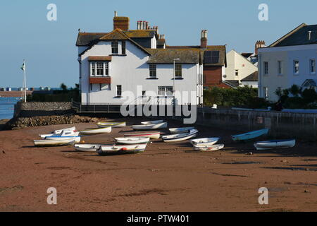 Beached boats by Shaldon Bridge beach - Stock Photo
