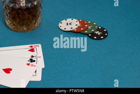 Cards and chips alcohol a blue background - Stock Photo