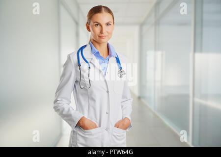 Doctor blonde in lab coat in the clinic. - Stock Photo