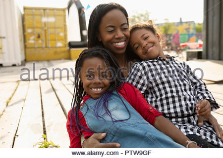Portrait smiling mother and daughters - Stock Photo
