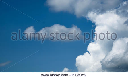 Arc of  cumulonimbus Clouds against a bright blue sky. Just the sky and the beautiful clouds. - Stock Photo