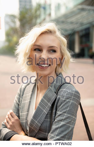 Portrait smiling, confident young businesswoman - Stock Photo