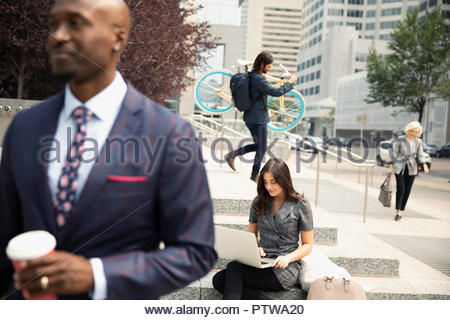 Business people working and walking in city - Stock Photo