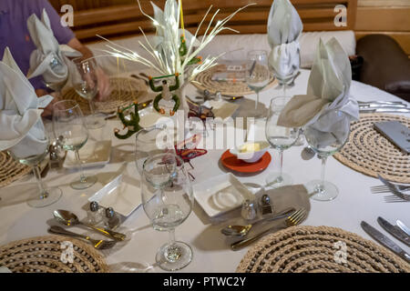 Peru, South America.  Table decorations with handmade sloths and butterflies on a tour boat. - Stock Photo