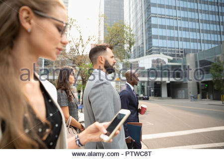 Business people crossing city street - Stock Photo