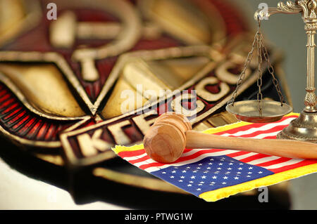 scales of justice, wooden gavel and United States flag on background with coat of arms of the state security Committee of the USSR (KGB) - Stock Photo