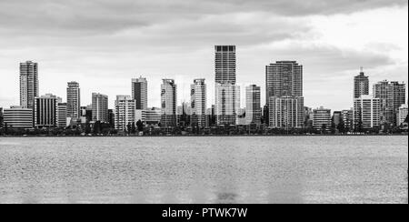 Black and White. Skyline of East Perth with swan river. View from South Perth, Perth, Western Australia - Stock Photo