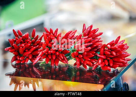 PeperoniOne of (9) images relating to various vegetables for sale on stalls in Munich's Market. The Chillies are priced in Euros and are in German. - Stock Photo