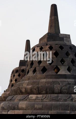 Some stupas of Borobudur temple, a buddhist complex in Java, Indonesia. - Stock Photo